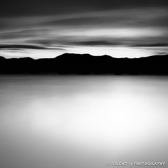 Tahoe Sunrise (Silent G Photography) Tags: california ca longexposure blackandwhite bw lake blur mountains clouds contrast sunrise movement ghost smooth tahoe laketahoe minimal explore squarecrop 1x1 tahoecity explored 10stopndfilter bwnd110 nikond7000 nikkor1635mmf4 markgvazdinskas silentgphotography