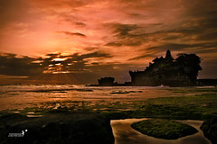 The sky broke like an egg into sunset and the water caught fire.. (achew *Bokehmon*) Tags: sunset red wallpaper bali orange cloud rock indonesia landscape waves sony tide egg dramatic tourist scenary alpha yolk tanahlot a850 achew