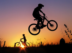 Twilight Riders (Marcelo-Vieira) Tags: sunset sports bike fly flying jump jumping twilight colorful extreme mountainbike downhill dh radical biker sihouette xtreme bycicle flickrchallengegroup flickrchallengewinner