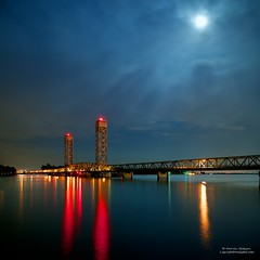 A Midnight Moon over Rio Vista Drawbridge (Darvin Atkeson) Tags: sanfrancisco california bridge blue summer storm night river landscape photography three highway long exposure bridges delta midnight bayarea drawbridge sacramento 12 slough mile twelve darvin atkeson darv liquidmoonlightcom
