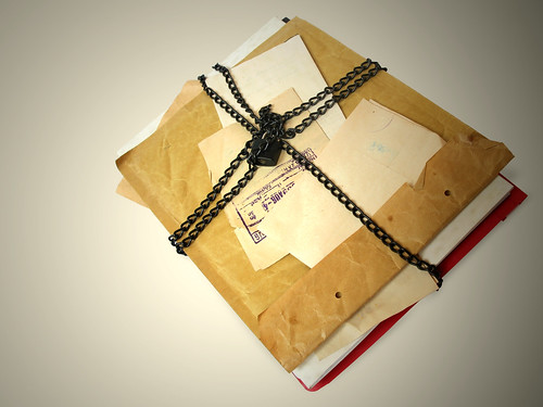 A journal tied up in string, filled with someone's secrets from the past