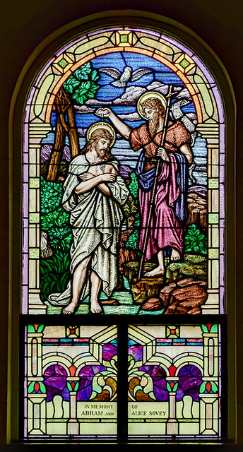 Holy Cross Roman Catholic Church, in Cuba, Missouri, USA - stained glass window of the Bapism in the Jordan
