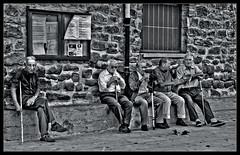 Kool and the Gang. (PiggBox.) Tags: street old white black building men monochrome stone wall walking sticks spain candi