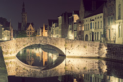 In Bruges 7/7: Koningsbrug & Poortersloge (Allard One) Tags: city longexposure bridge streets tower architecture night reflections canal still nikon europe cityscape belgium belgie toren brugge surreal peaceful medieval illuminated september unescoworldheritagesite nighttime le bruges kingsbridge unreal portfolio flemish rei afterdark architectuur gettyimages gracht flanders photogenic charlesdickens antonpieck nle vlaanderen stilness veniceofthenorth capitalcity 2011 traveldestinations middeleeuws famousplace reflecties koningsbrug verlicht fotogeniek nikcolorefexpro spinolarei janvaneyckplein poortersloge notasoularound d700 spiegelrei rustiek nighttimelongexposure nikond700 historiccitycentre nikkor2470mmf28 nikonfx allardone aandewandel allard1 burgherslodge vintagetoning canalbased fullframepower allardspecialblend zevenklapper allardschagercom