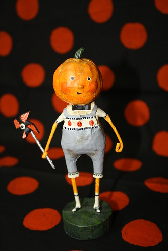 Pumpkin kid with pinwheel