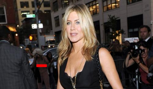 Jennifer Aniston's Cleavage Overshadowed By Topless Photojournalist Holly Van Voast