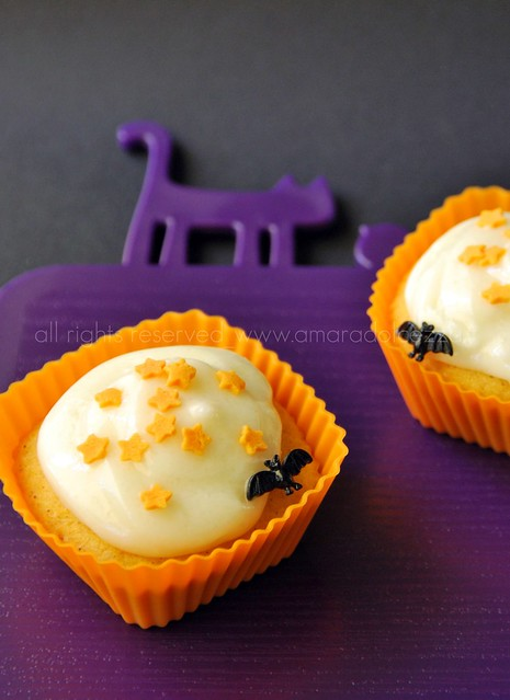 pumpkin cupcake with frosting cheese