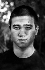 Lino (AndrewLuellen) Tags: boy white black photoshop asian photography nikon gritty lino d3000