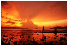 Gold Sky (Dolly MJ) Tags: sunset beach water waves slowshutter kotakinabalu redsky sabah southchinasea longexpose ombak beautifulsunset borneoisland goldsky northborneo kksunset
