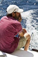 The Old Man and the Sea (dirac3000) Tags: old sea italy man boat europe mediterranean cigarette smoke captain hemingway salento puglia