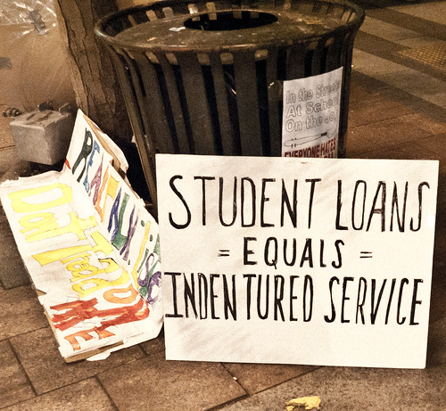 A sign sits on the sidewalk at the Occupy Wall Street protest.