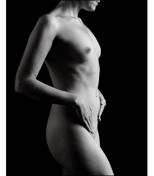 Woman poses for a dramatic nudes photograph in profile.