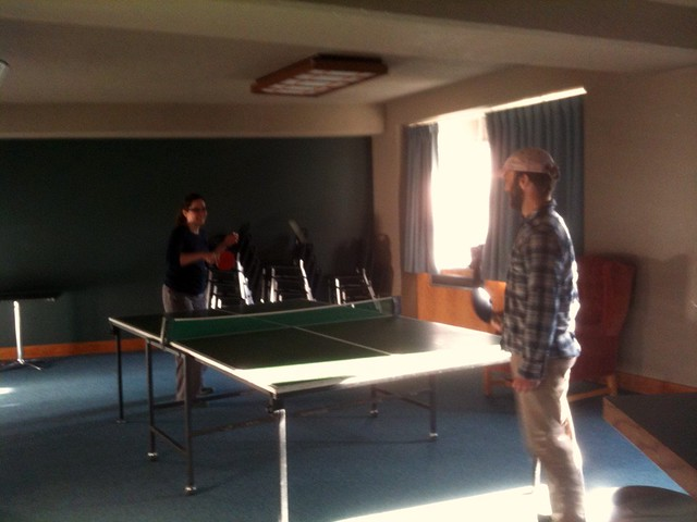 Playing ping pong.