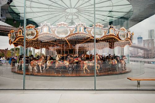 Looking at the Carousel, you can see the Brooklyn Bridge in the background.