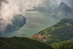 Nestled (Br, Switzerland) (jpaulus) Tags: lake mountains alps clouds shadows village lugano d700