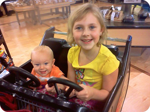 Sisters drivin' the grocery cart