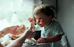 2/Lunch on the train (Hanna IV Photography) Tags: summer portrait people film girl kids train fun 400 fujifilm belarusian zenite