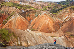 Rhyolite wonders (Thierry Hennet) Tags: summer orange brown man green yellow rock stone zeiss landscape outdoors iceland aqua hiking sony scenic erosion highland ambient polarizer cloudysky ocre mountainrange landmannalaugar traveldestinations beautyinnature a900 highangleview cz2470mmf28