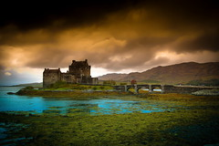 The Castle and The Storm (Explored #9) (PeterYoung1.) Tags: light shadow storm mountains castle clouds scotland scenic storms eileandonan