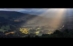 Shafts of Light (Paul Newcombe) Tags: uk light england english landscape countryside cloudy derbyshire peakdistrict stormy telephoto british surpriseview shaft hathersage longlens millstoneedge tamron18200