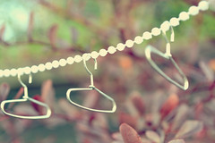 too young to notice and to dumb to care. (Lauren Anisha) Tags: love happy beads funny pretty little sweet bokeh small young tiny coathangers childrenstoys growup nevergrowup