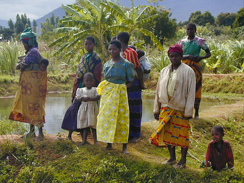 Women and children standing by a fish pond, photo by WorldFish, 200531 Africa