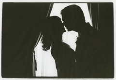 Couple in window - a monochrome