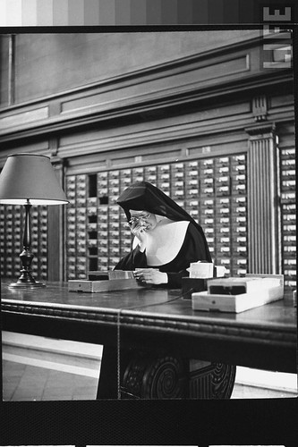 nun using card catalog