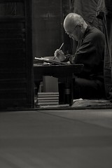 signing the shuincho (StephenCairns) Tags: work monk brush priest calligraphy pilgrimage f4 pilgrim seiza    shuin fude  canon50d tanigumi kegonji    70200mmf4isusm  headmonk junrei  shuincho tanigumisan onocho