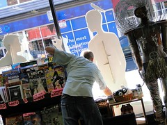 Anders setting up his Big Questions Window Display (friendshipisterrible) Tags: windowdisplay andersnilsen bigquestions quimbysbookstore