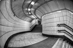 Ooooo, Curves.... - Explored (Sean Batten) Tags: uk light england bw london lines stairs underground nikon curves tube steps corridor fisheye tiles hdr oxfordcircus d90