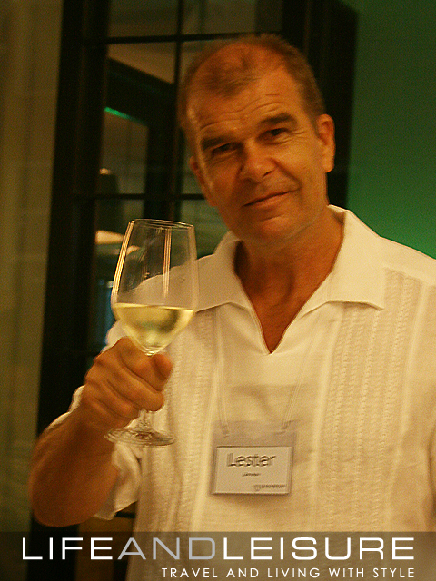 Lester from Zen Asia raises a toast to the successful wine event