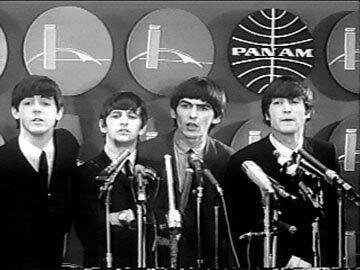 Beatles in front of Pan Am logo