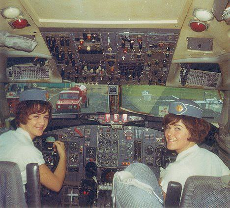 Pan Am stewardesses in cockpit