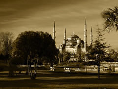 Blue mosque in Istanbul, Turkey (Pavel Chonya) Tags: city travel urban blackandwhite bw building tourism architecture buildings turkey religious dawn town asia view minaret muslim islam religion trkiye olympus istanbul mosque dome bluemosque sephia zuiko turkish minarets e330 zd 1445mm sultanahmedmosque thesultanahmedmosque