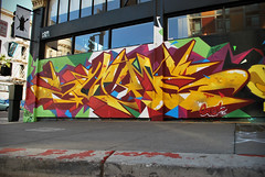 Shaded Yellow (Scotty Cash) Tags: sf color art graffiti san paint gallery geometry steel fast exhibition walls forward fransisco 1am nwk sueme 2011 9lives suiko
