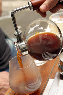 pouring siphon coffee