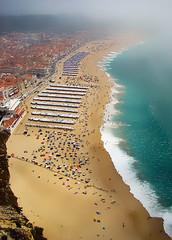 Nazare Beach in Portugal. (Carlos Vieira.) Tags: sea praia beach portugal sand colours nazar peaple
