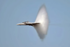 Super Hornet with Vapor Cone (mvonraesfeld) Tags: sanfrancisco speed flying cone aircraft aviation military flight jet wave shock boeing usn vapor fleetweek superhornet fa18f 2011 img0402 prandtlglauertsingularity