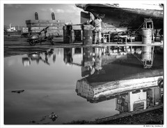 life is a mirror (Jordan_K) Tags: bw work wonderful mirror boat mood artistic scenic scene worker shipyard caulking perama bwart thedefiningtouch deftouch