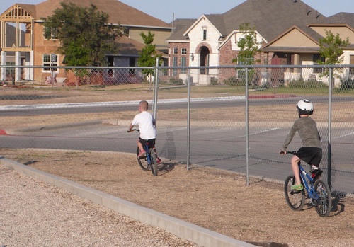 Bike riding at the school playground