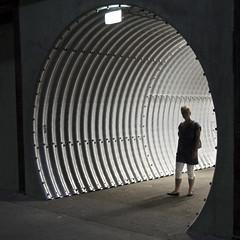 tunnel vision (Cybergabi) Tags: shadow silhouette backlight rotterdam tunnel round figure corrugatedmetal 5f heijplaat rdmcampus onderzeeboodloods theonethemany