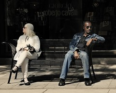 the urban divide (-liyen-) Tags: street city urban woman man bench candid explore sidwalk interestingness337 activeassignmentweekly bestofweek1 bestofweek2 bestofweek3 bestofweek4 bestofweek5 bestofweek6 thepinnaclehof tphofweek118