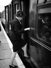 Climb Aboard (slaup) Tags: bw woman hat lady train carriage dress platform style railway nostalgia 1940s boarding steamrailway reenactor embsay climbaboard