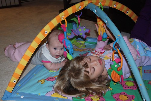 playing on the baby gym together