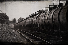 Toxic symmetry (f1design) Tags: railroad blackandwhite bw toxic train blackwhite dof tracks railway symmetry chemicals bwphotography tankers 400mm tankcars pinebeach railwaycars dorvalqc dorvalqubec chemicalcars