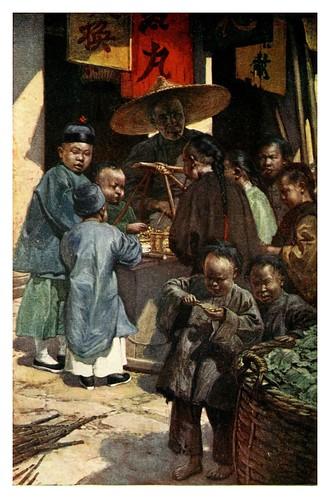 010-Niños alrededor de un puesto de dulces-China 1910- Norman H. Hardy