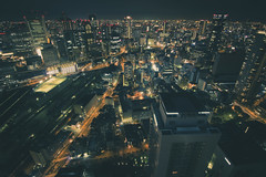 (skidu) Tags: city sky orange japan night canon eos long exposure angle bokeh lounge wide tokina osaka f11 umeda buidling 1116 550d