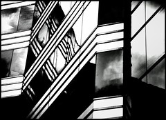 Diaganalysis (Book'em) Tags: windows blackandwhite bw toronto abstract geometric lines architecture buildings reflections nikon geometry angles d200 glss artinbw qualitystructuresppf