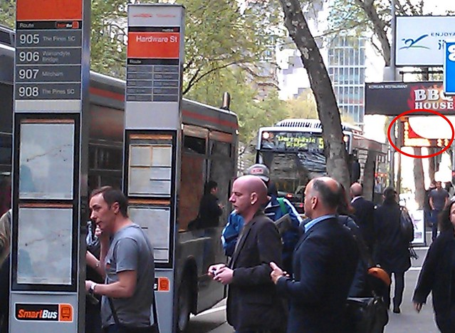 Smartbus indicators - too far from stops, and obscured by other signs